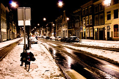 Winternight...... (zilverbat.) Tags: winter urban snow cold holland reflection history netherlands architecture buildings lights scenery exposure nightshot mud sneeuw nederland freezing nat denhaag zebra centrum thehague modder fiets winternight koud winterpret zebrapad reflectie schoonheid wegdek winternacht nachtopname winterkou gladheid stilleveerkade vriesweer zilverbat