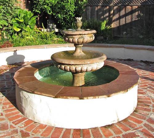fountain in long morning light