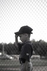 Carson (Camille Weaver) Tags: boy portrait blackandwhite bw hat fence carson 50mm kid nikon child baseball little brother walk sweaty cap tired nikkor 18 exhausted littleleague teeball d80