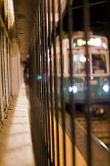Green Line Behind Bars (Eric Kilby) Tags: city green window station night bars platform cage line mbta lechmere