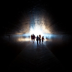 I remember 8 years ago... (MightyBoyBrian) Tags: park light black holland up ahead silhouette mi contrast canon dark square rebel xt day angle bright weekend labor wide tunnel 11 vision crop figures 1022mm f35 beachgoers beachgoer michiganinpictures