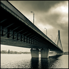 Shroud Bridge (Georgios Karamanis) Tags: bridge sky bw white black water clouds river cable latvia lamppost shroud gorky riga daugava vanu karamanis gorkija