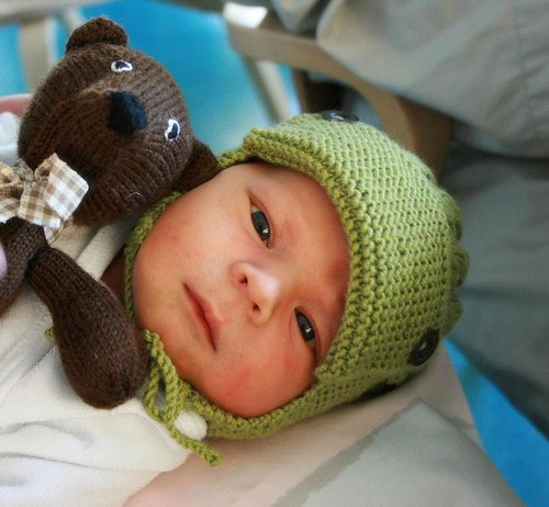 My nephew with the first knitted gifts from auntie Vilma <3