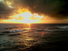 Sunset at Galle Face (DimuthuCharu Photography) Tags: red sea sky sun beach water yellow refelction