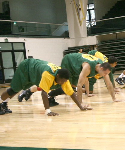 The USF Dons stretch to warm up at the beginning of practice.  Photo by Matt Steinbach/Foghorn