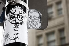 sewn/stitched up (damonabnormal) Tags: street city urban streetart philadelphia canon graffiti sticker stickerart december 33 label stickers streetphotography dec urbanart pa labels philly slap phl 215 slaps uwp citystickers streetstickers goest underwaterpirates philadelphiastreetart 40d philadelphiagraffiti philadelphiaartist