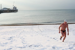 Angus in the Snow (yvoluna) Tags: sea mer snow beach club swim pier crazy brighton angus snowy swimmer neige mad fou