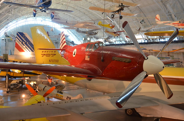 "Steven F. Udvar-Hazy Center: North American P-51C, ""Excalibur III"", with tails of Concorde & Boeing 707 in background"