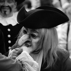 Kiss (Svedek) Tags: portrait people bw face hat square nose kiss mask documentary 500x500 aplusphoto