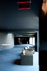 Alone (nosha) Tags: blue light shadow red window minnesota architecture modern chair nikon pattern theatre minneapolis august 24mm mn 2009 modernarchitecture guthrie lightroom f40 d300 blackmagic nosha 130sec 0ev 18200mmf3556 nikond300 noshalikes 130secatf40 ul20090809