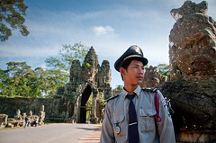 The Guide at South Gate of Angkor Thom (Mario Wibowo, ARPS) Tags: blue portrait male guy english french model nikon gate cambodia south thom guide siemreap angkor 18200 vr d300