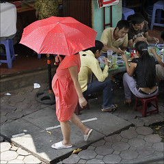 Street scene in HaNoi (NaPix -- (Time out)) Tags: street red woman umbrella scene pregnant millennium vietnam celebration hanoi hni canonef70200mmf4lisusm canonef14xiiextender thnglong napix nhathohanoicathedral