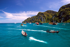 Island Hopping (DolliaSH) Tags: trip travel sea vacation holiday color tourism colors canon thailand boats island photography photo asia southeastasia foto tour place photos bangkok kingdom tailandia visit location tourist thalande explore journey thai destination traveling visiting siam fareast thailandia 18200 longtail touring phiphiisland tailand phiphidon longtailboats explored thaimaa thajsko constitutionalmonarchy southeasternasia canoneos50d dollia dollias sheombar dolliash subregionofasia