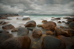 stone beach after the rain - take 2 (H o g n e) Tags: ocean longexposure sea summer sky cloud seascape motion beach water norway rock stone clouds landscape evening coast landscapes carved solitude waves seascapes wind dusk horizon smooth shoreline wave glacier erosion explore pebble shore silence glaciers pebblebeach geology archipelago jren breakingwaves carvedstone carvedrock smoothwater explored smoothsurface smoothstone brusand smoothrock pprowinner silkwater
