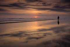 alone (Helminadia Ranford(New York)) Tags: sunset bali seascape reflection beach skyscape indonesia landscape photography alone passion kuta helminadia