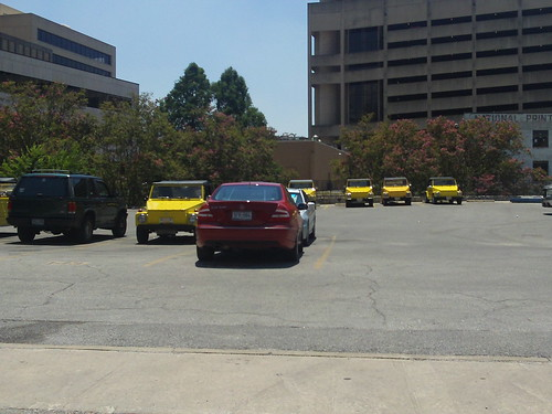 yellow cars all in a row