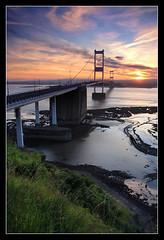 Bridge over muddy waters (Roger.C) Tags: bridge sunset sky sun water beauty wales clouds river evening motorway mud severn platinumheartaward