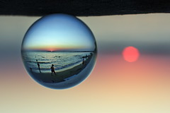 sunset at vouliagmeni:  200/365 (helen sotiriadis) Tags: sunset sea sun beach water glass canon ball published dof crystal bokeh athens depthoffield greece sphere refraction 365 canonef50mmf14usm vouliagmeni αθήνα canoneos40d βουλιαγμένη toomanytribbles