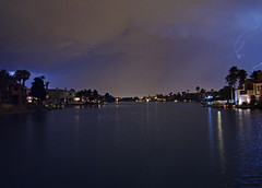 Stormy Weather over the Lake in Las Vegas (John Petrick) Tags: longexposure storm rain night nightshot lasvegas lightning storms thelakes stormyweather intheneighborhood lasvegasnv lasvegasnevada lookingnorth lasvegasatnight lakereflections 89117 lasvegaslongexposure dsch50 julystorms lasvegasnightshot thelakeslasvegas julythunderstormsinlasvegas lookingtowardsnorthlasvegas lightninginlasvegas lasvegasstorms lasvegaslightning thelakesneighborhoodlasvegas stormylasvegas lasvegasthunderstorms vegasstorms