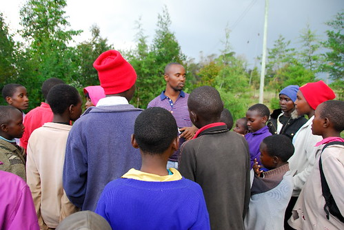 Charles talks to the kids of Lelmolok