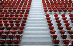 160 red seats and one baldhead (Toni_V) Tags: red abstract stadium seat zurich zürich 2009 d300 letzigrund letzi toniv dsc0196