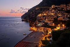 Positano in the Evening (Pierpaolo.) Tags: old longexposure trees houses sunset red sea summer sky italy panorama love beach church nature water colors beautiful yellow alberi clouds landscape boats lights warm europa europe mediterraneo italia tramonto nuvole mare campania village estate view natural horizon places august natura panoramic barche case chiesa agosto giallo cielo vista napoli romantic luci piccolo acqua rosso colori 2009 spiaggia romantico sera vecchio orizzonte caldo paese bellissimo promontorio paesino costieraamalfitana bellezze colorate canoneos30d magicatmosphere mediterrranean sigma10201020mm