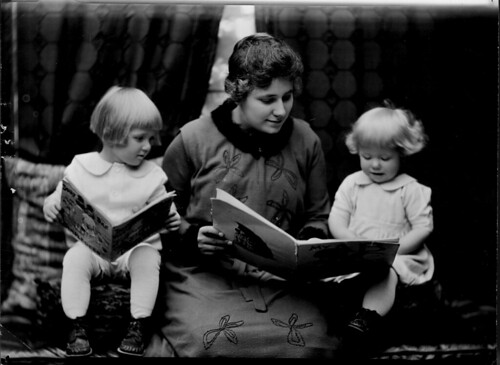 Student reading to two little girls. Photographed for 1920 home economics catalog by Troy.