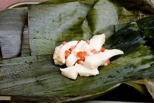 wrapping flounder with banana leaves