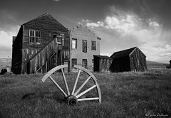 Old West Reminiscence (Laura Ashburn Photography) Tags: california park wood old usa laura west wheel clouds canon buildings wagon photography town state ghost 5d bodie sierras eastern ashburn