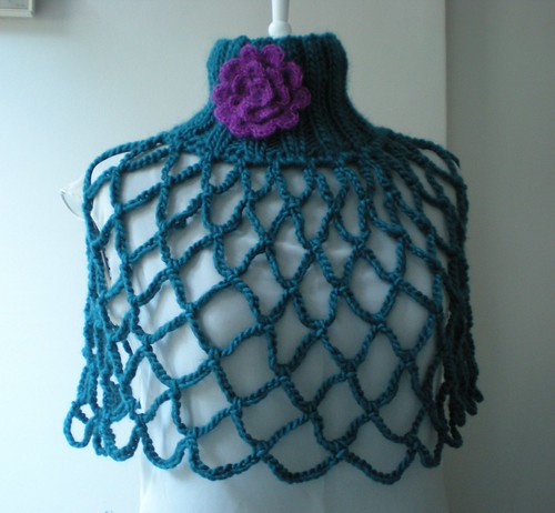 teal green poncho by you.