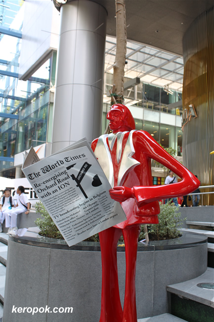 the red man reading the papers at ion
