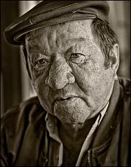 Man in Taska, Madeira (shonkathan) Tags: portrait man flower sepia nose mono big australia brisbane glen queensland madeira
