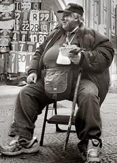 San Lorenzo Market, Florence, Italy (dleiva) Tags: people italy man male blancoynegro smile fashion shopping stand florence clothing san italia commerce market action culture stall lorenzo tuscany florencia firenze merchandise toscana jackets environmentalportrait fiorence