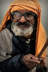 A character. India (fredcan) Tags: travel portrait india man face beard glasses humanity character indian oldman begger southasia lungi madhyapradesh orchha indiansubcontinent