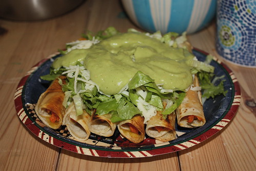 topped with spicy guacamole, cheese, and lettucce.