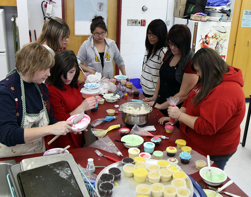 DHS Student learn to decorate cupcakes under the guidance of Mrs. Ambridge and Mrs. Adams.