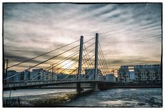 Bridge to the new morning (BigWhitePelican) Tags: helsinki finland jätkäsaari crusellinsilta morning sunrise clouds sea frozen winter canoneos70d adobelightroom6 niktools 2017 february