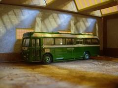 In the old bus station (Elsie esq.) Tags: old building bus coach model factory nimbus crane scrapyard oo scrap gauge busstation albion oogauge maidstoneanddistrict