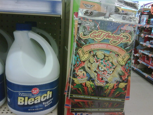 Ed Hardy temporary tattoos on a Walgreens endcap right next to bleach