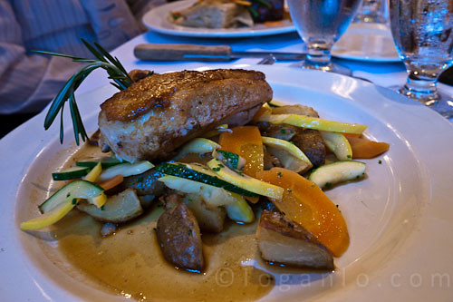 Chicken on a bed of vegetables pictures
