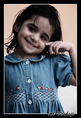 Just a Smile (Al-Kooheji) Tags: summer portrait baby cute girl smile canon shower kid sweet just maryam مريم بنت صورة ياهل ابتسامة طفل صيف طفلة alkooheji الكوهجي