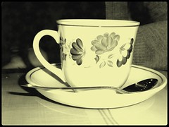 Have a Sip! (Tasmin_Bahia) Tags: flowers blackandwhite black leaves vintage blackwhite pretty hand tea framed peaceful spoon indoors mat frame teacup delicate cardigan saucer froth tasminbahia