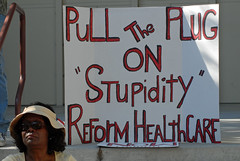 (ONE/MILLION) Tags: people signs money america politics cost culture lobby congress health stupid government bonus projects care priority speech reward idiots healthcare insurance greed favors freedoms reform whocares bottomline plummer provider onemillion ceos randsome arizonarepublic not williestark payup obamaphxpro