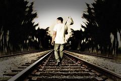 these train tracks take me away (Travis Christian) Tags: railroad blur train bag tracks away running stick radial