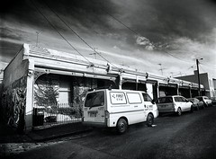 fitzroy gothic #7 (mugley) Tags: city sky urban blackandwhite bw cars 120 film architecture clouds rollei buildings mediumformat 645 fitzroy grain terraces perspective first australia melbourne wideangle victoria scan vehicles negative wires epson parked van polarizer courier 6x45 streetscape r3 antennae mamiya645 aerials urbanlandscape redfilter polariser 25a id11 v700 cloudage keystoning mamiya645protl ilfotec m645 rolleir3 greevesst 35mmf35sekorn