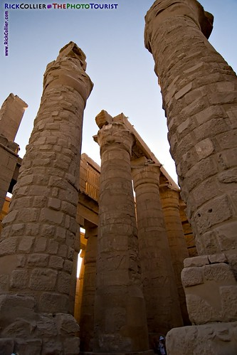 Massive unfinished columns and shadows create a looming feel at the back of the hypostyle hall at Karnak Temple, near Luxor, Egypt.