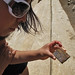#39 Adriana examining picture stone at newly excavated ruins of Atzompa, Oaxaca, southern MEXICO