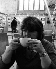 Woman with Coffee Cup (Christopher West) Tags: cathedral stdavids