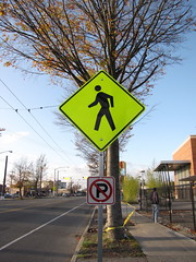 Will a bright yellow pedestrian warning sign get drivers attention? Photo by Wendi.