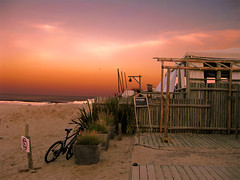 Jose Ignacio sunset - Uruguay (nina's clicks) Tags: travel sunset sea summer vacation sky beach bicycle canon uruguay restaurant sand sundown playa puntadeleste joseignacio noparkingsign sentido lahuella restaurantbythesea